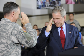 Bush salutes as Downer introduces him to speak about the Gulf Coast recovery from hurricanes Katrina and Rita, at Jackson Barracks in New Orleans, Louisiana