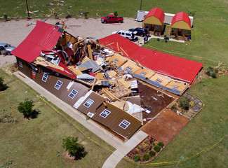 The Rustic Barn, an event hall, which suffered major tornado damage, is seen from an unmanned aerial vehicle in Canton, Texas