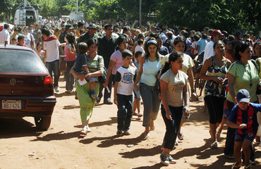 Crowd of people march to block main highway in protest after yellow fever vaccinations ran out in Laurelty-Luque
