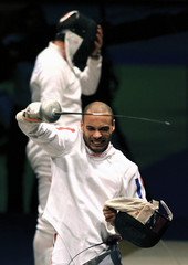 France's Jeannet celebrates after winning the gold medal against Spain in the men's team epee final in Turin