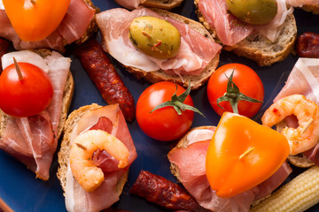 Spanish tapas starters on blue plate