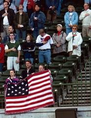 MILWAUKEE BASEBALL FANS DISPLAY AMERICAN FLAG.