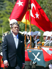 Ukrainian President Viktor Yushchenko reviews the honour guard during a welcoming ceremony in Ankara.