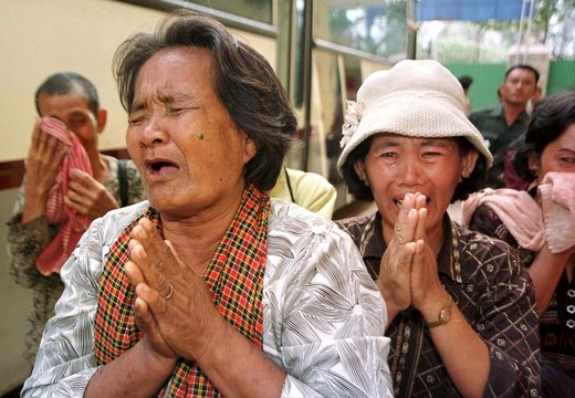 RELATIVES OF DEFENDANTS CRY OUTSIDE PHNOM PENH'S COURTHOUSE AFTER SENTENCING.