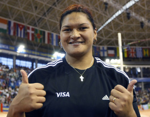 The winner of the women's shot put final, Vili of New Zealand, gives thumbs up after the competition at the IAAF World Indoor Athletics Championship in Valencia