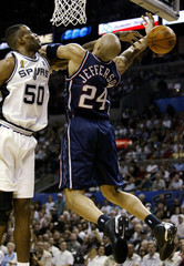 SPURS ROBINSON BLOCKS SHOT BY NETS JEFFERSON IN NBA FINALS GAME 2.