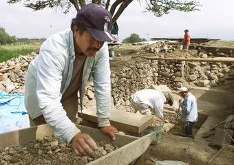 ARCHEOLOGICAL WORKER SORTS EARTH DUG FROM INSIDE PYRAMID OF THE MOON INTEOTIHUACAN.