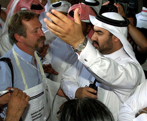 Qatari security men stop the French anti-globalisation protester Jose Bove and other demonstrator at..