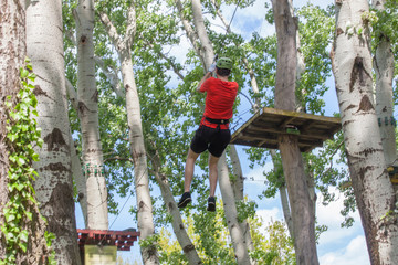 young man on zipline in adventure park