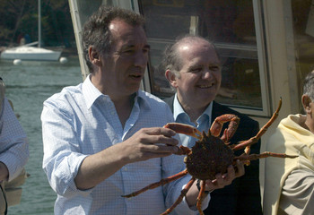 France's UDF presidential candidate Francois Bayrou shows a crab, next to Francois Goulard, as he campaigns in Vannes, western France, April 15, 2007