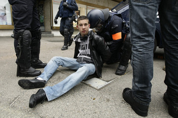 Riot policemen detain people during a demonstration against the World Economic Forum in Geneva