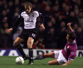 MANCHESTER UNITED'S GARY NEVILLE IS SLIDE TACKLED BY ASTON VILLA'S LEEHENDRIE DURING THEIR FA CUP THIRD ...