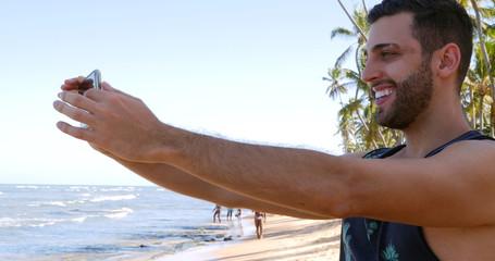 Man taking a selfie in a tropical beach
