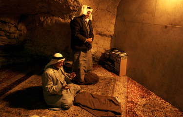 Two Muslims pray inside Al Aqsa compound during the Muslim fasting month of Ramadan in Jerusalem