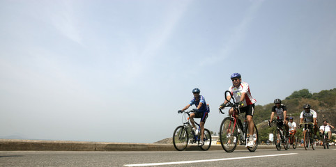 Residents ride their bicycles along Leblon beach to celebrate the International Car Free Day in Rio de Janeiro