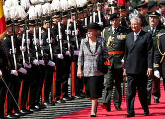 Queen Beatrix of the Netherlands and Belgium's King Albert II review a honour guard in Antwerp