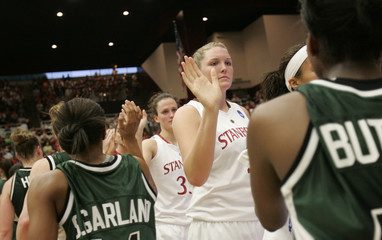 Stanford University's Appel is congratulated by Cleveland State players after their NCAA basketball game in Palo Alto