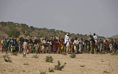Villagers from the Dadjo tribe celebrate the circumcision of the chief's son at the village Koubogou in eastern Chad