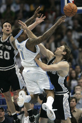 Denver Nuggets' J.R. Smith is defended by San Antonio Spurs' Manu Ginobili and Brent Barry in Denver