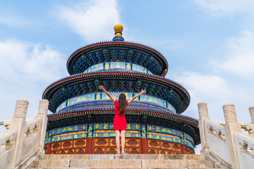 Wall Mural - Woman success and joy on china travel lifestyle. Winner standing with arms up of happiness in front of temple of heaven in Beijing. Asia summer destination. Imperial complex of religious buildings.
