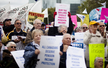 Former employees and pensioners of Nortel Networks Corp gather in front of Queen's Park to protest the loss of pensions and severance pay in Toronto