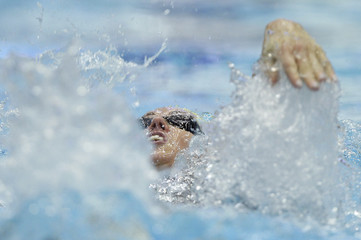 Alshammar of Sweden competes in the women's 100 metres individual heats at the swimming World Cup in Berlin