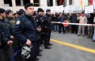 Turkish riot police face Communist Party members during a demonstration in front of British Consulate in Istanbul