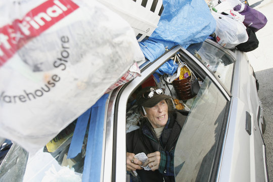 Love is seen in her car, in which she lives, surrounded by her belongings in Los Angeles