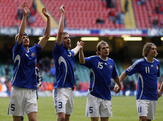 Finland players celebrate defeating Wales 2-0 in their 2010 World Cup qualifying soccer match in Cardiff