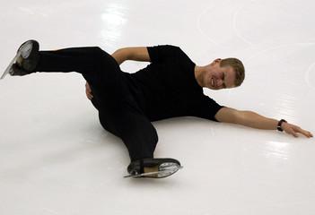 BULGARIAN DINEV FALLS DURING OLYMPICS FIGURE SKATING PRACTICE IN SALTLAKE CITY.