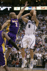 Utah Jazz Williams  shoots over Los Angeles Lakers Fisher in Salt Lake City