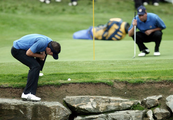 European Ryder Cup players Olazabal and Garcia line up a shot during their fourball golf match at the Ryder Cup in County Kildare
