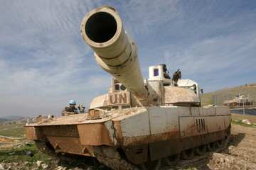 French tanks and soldiers of United Interim Forces in Lebanon patrol in Maroun Al Ras village
