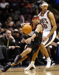 PHILADELPHIA 76ERS IVERSON DRIVES BY NEW JERSEY NETS KITTLES.