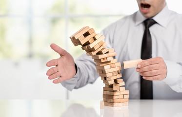 Businessman Fails Building Tower, Business Concept