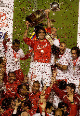SC Internacional's Fernandao holds up the trophy after winning the Copa Libertadores title in Porto Alegre