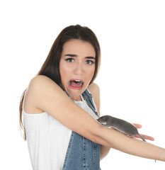 Young woman with funny rat on white background