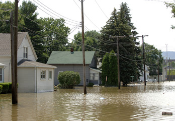 Flooded streets, like this one in Johnson City, caused homes to be evacuated in parts of upstate New York