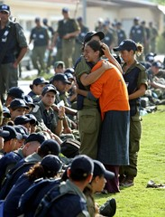 Jewish settler cries in front of Israeli police and soldiers in Neve Dekalim settlement in Gush ...