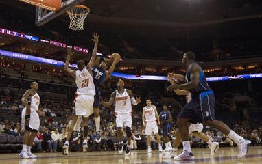 Dallas Mavericks' James Singleton shoots over Charlotte Bobcats' Alexis Ajinca during NBA basketball game in Charlotte