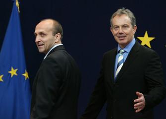 British PM Blair greets Polish PM Marcinkiewicz at EU summit in Brussels
