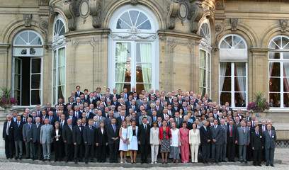 French Foreign Minister Douste-Blazy poses during a family photo of French ambassadors in the ...