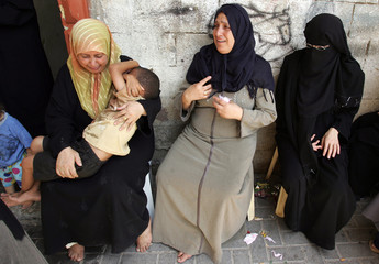 Relatives of Mohammed Abu Abdoh mourn during funeral in Maghazi camp in central Gaza