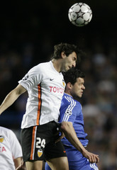 Valencia's Moretti jumps for the ball with Chelsea's Ballack in London