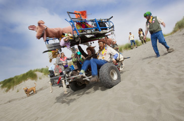Contestants in the 40th annual Kinetic Grand Championship race their people-powered kinetic sculpture down the sand dunes in Manila