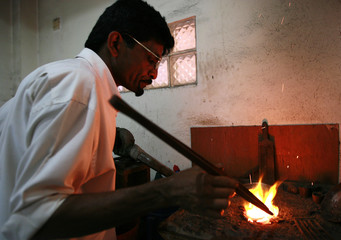 Saman L melts gold in coal fire at a jewellery workshop in Colombo