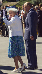 THE QUEEN WAVES TO CHEERING PEOPLE AS SHE LEAVES CHURCH IN CANBERRA.