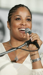 Laila Ali speaks at a news conference in Washington prior to her bout against Erin Toughill.