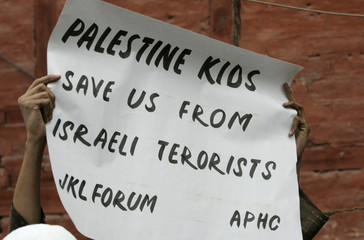 Activist of JKLF holds placard during protest against Israel's offensive in Gaza, in Srinagar