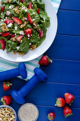 Fresh organic strawberry spinach salad